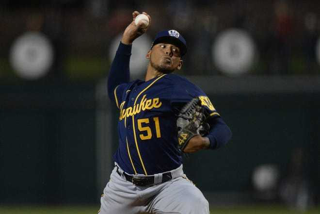 Freddy Peralta delivers a pitch in Spring Training. (Joe Camporeale/USA TODAY Sports)