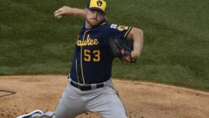 Milwaukee Brewers starting pitcher Brandon Woodruff (53) throws the ball against the Chicago Cubs during the first inning of an opening day baseball game Friday, July, 24, 2020, in Chicago. (AP Photo/David Banks)