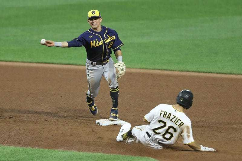 Luis Urias helps to turn a double play against the Pittsburgh Pirates. (Photo courtesy of Charles LeClaire/USA TODAY Sports)