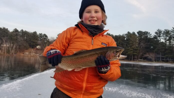 A young Wisconsin angler with a beautiful Rainbow Trout caught by suspending a fathead under a tip-up just off the break.