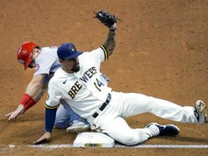 Brewers' Jace Peterson tags out Cardinals' OF Tommy Edman during a 2020 regular season game.
